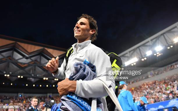 Spain's Rafael Nadal smiles after beating Bosnia's Damir Dzumhur in their men's singles third round match on day five of the Australian Open tennis...