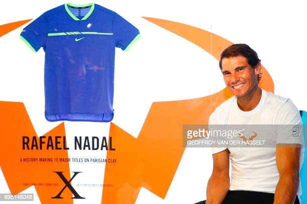 Spain's Rafael Nadal smiles during in a promotional event at the Nike Store on the ChampsElysees avenue on June 12 2017 in Paris a day after he won...