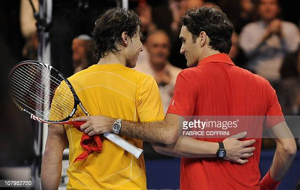 Spain's Rafael Nadal speaks with Switzerland's Roger Federer after their charity tennis game on December 21 2010 in Zurich The Match for Africa is...