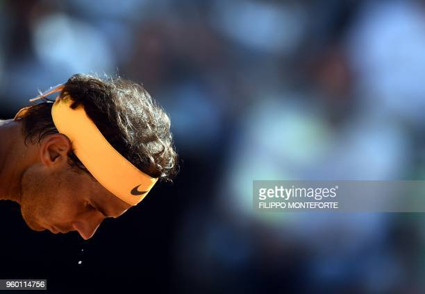 Spain's Rafael Nadal sweats as playing against Serbia's Novak Djokovic during their semi final match at Rome's ATP Tennis Open tournament at the Foro...
