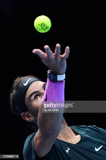 Spain's Rafael Nadal tosses the ball to serve against Greece's Stefanos Tsitsipas in their men's singles round-robin match on day five of the ATP...