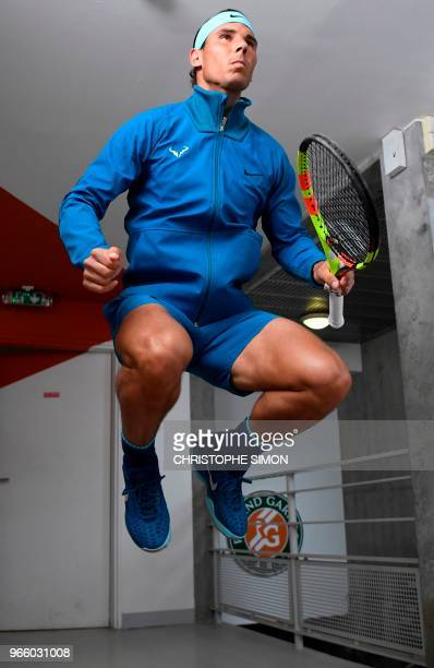 Spain's Rafael Nadal warms up ahead of his men's singles third round match against France's Richard Gasquet on day seven of The Roland Garros 2018...
