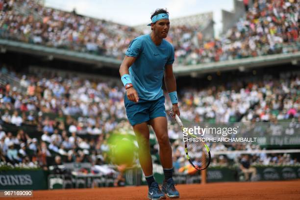 Spain's Rafael Nadal watches a ball during his men's singles fourth round match against Germany's Maximilian Marterer on day nine of The Roland...