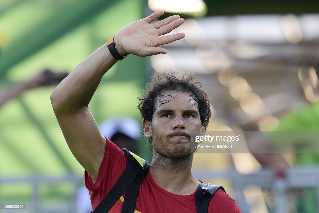 TOPSHOT - Spain's Rafael Nadal waves after losing to Japan's Kei Nishikori in their men's singles bronze medal tennis match at the Olympic Tennis Centre of the Rio 2016 Olympic Games in Rio de Janeiro on August 14, 2016. /