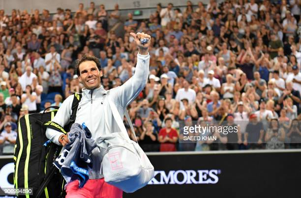 Spain's Rafael Nadal waves to the crowd after beating Bosnia's Damir Dzumhur in their men's singles third round match on day five of the Australian...