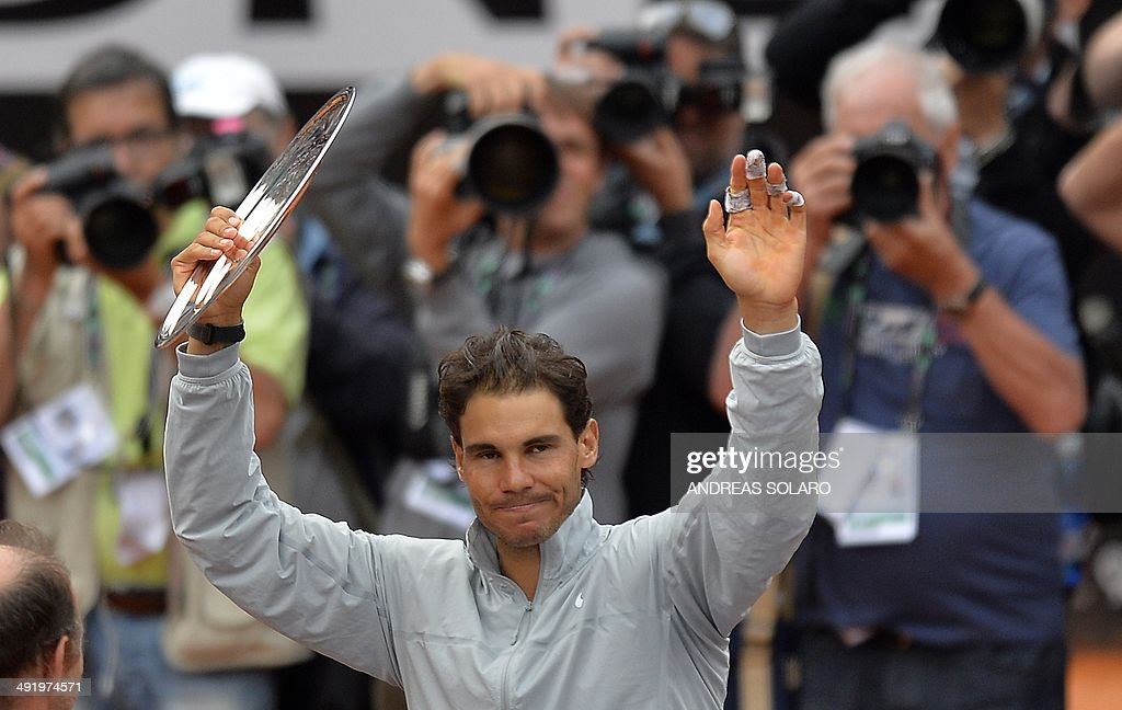 Spain's Rafael Nadal waves with his trophy after being defeated during the ATP Rome's Tennis Masters final against Serbia's Novak Djokovic on May 18, 2014 at the Foro Italico in Rome. Djokovic won 4-6, 6-3, 6-3.