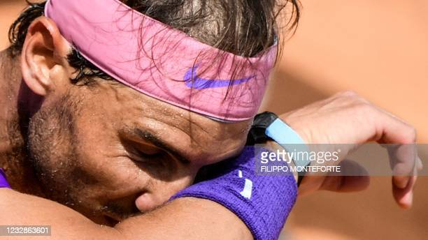 Spain's Rafael Nadal wipes his face during his match against Canada's Denis Shapovalov of the Men's Italian Open at Foro Italico on May 13, 2021 in...