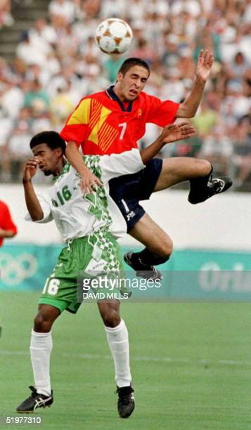 Spain's Raul Blanco Gonzalez collides with Saudi Arabia's Khamis AlDossari as he goes for a header during the first half of their Olympic soccer...