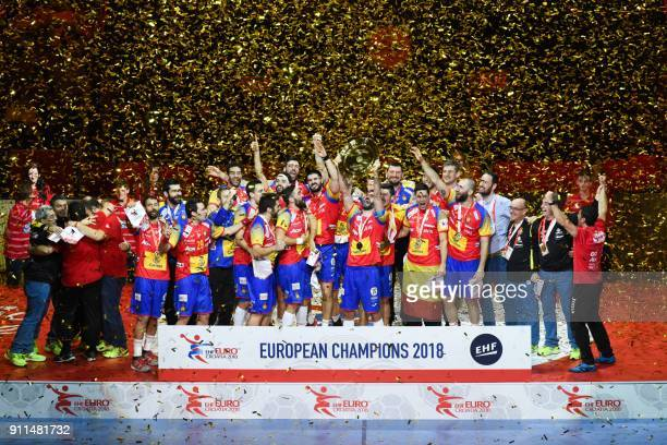 Spain's Raul Entrerrios holds EHF European Handball Championship trophy as Spain's players celebrate during the podium ceremony after winning the...
