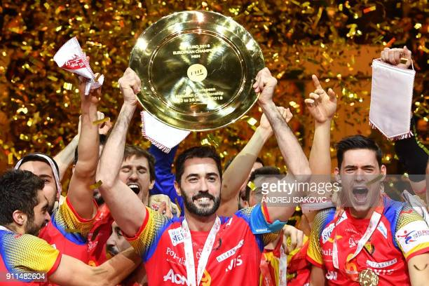 TOPSHOT Spain's Raul Entrerrios holds EHF European Handball Championship trophy as Spain's players celebrate during the podium ceremony after winning...