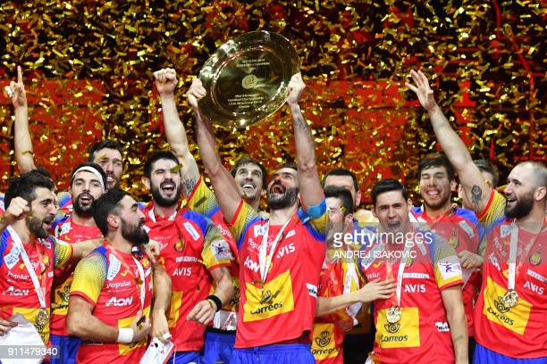 Spain's Raul Entrerrios holds the EHF European Handball Championship trophy as Spain's players celebrate during the podium ceremony after winning the...