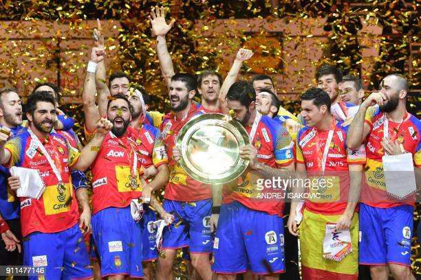 TOPSHOT Spain's Raul Entrerrios kisses the EHF European Handball Championship trophy as Spain's players celebrate during the podium ceremony after...