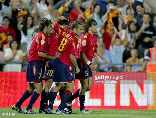 Spain's Raul Gonzalez Fernando Morientes Ruben Baraja and Carles Puyol celebrate after scoring their first against Andorra during a preEuro 2004...
