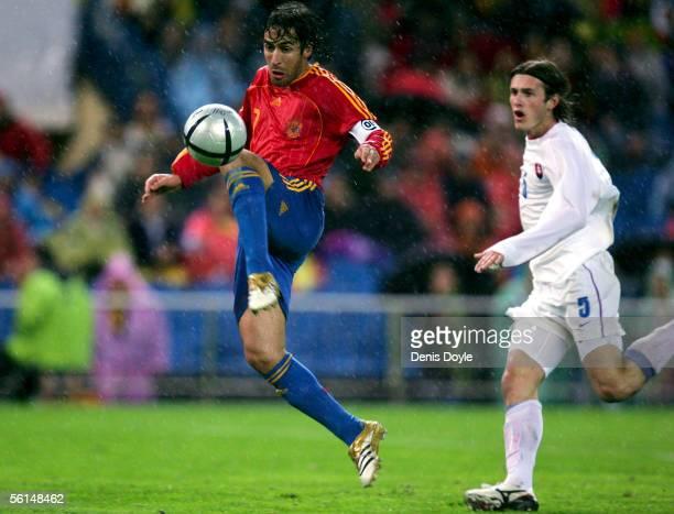 Spain's Raul Gonzalez makes away with the ball beside Slovakia's Miroslav Karhan during a World Cup qualifier playoff first leg match between Spain...