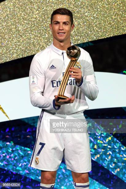 Spain's Real Madrid Cristiano Ronaldo holds the trophy of the golden ball as the team won the final of the FIFA Club World Cup in Yokohama suburban...