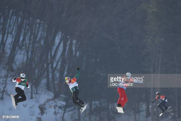 Spain's Regino Hernandez, Australia's Jarryd Hughes, France's Pierre Vaultier and US Mick Dierdorff compete in the men's snowboard cross big final at...