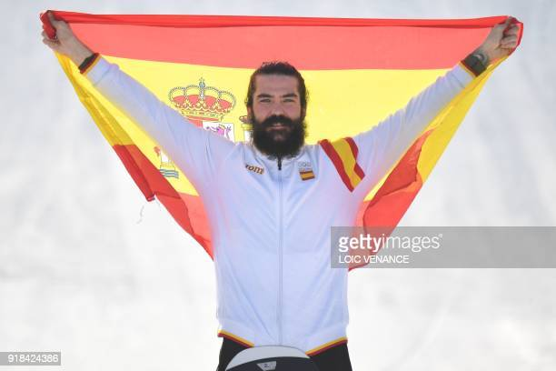 Spain's Regino Hernandez celebrates on the podium after the men's snowboard cross big final at the Phoenix Park during the Pyeongchang 2018 Winter...