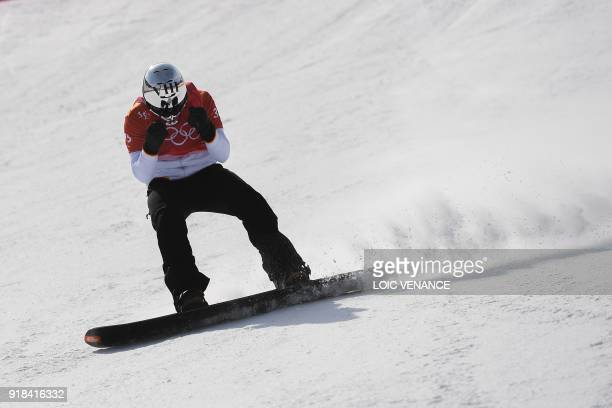 Spain's Regino Hernandez reacts after a men's snowboard cross semi-final at the Phoenix Park during the Pyeongchang 2018 Winter Olympic Games on...