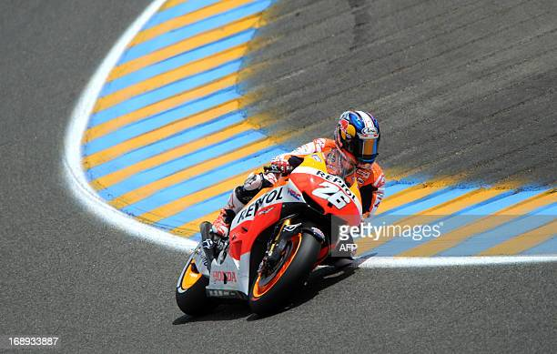 Spain's rider Dani Pedrosa drives his Honda in a curve during a second free practice session at Le Mans' circuit western France on May 17 2013 two...
