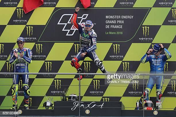 Spain's rider Jorge Lorenzo Winner secondplaced Italy's rider Valentino Rossi and thirdplaced Spanish's rider Maverick Vinales celebrate on the...