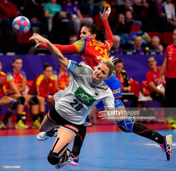 Spain's right back Almudena Rodriguez defends against Germany's left wing Franziska Muller during the 2018 European Women's handball Championships...