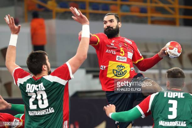 Spain's right back Jorge Maqueda jumps to shoot during the 2021 World Men's Handball Championship match between Group I teams Spain and Hungary at...