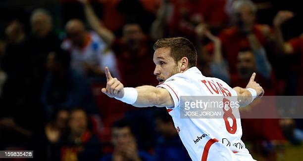 Spain's right wing Victor Tomas celebrates after scoring during the 23rd Men's Handball World Championships round of 16 match Serbia vs Spain at the...