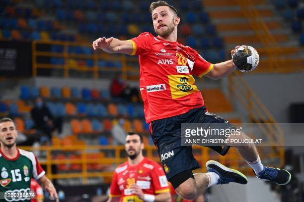 Spain's right winger Aleix Gomez Abello jumps to shoot during the 2021 World Men's Handball Championship match between Group I teams Spain and...
