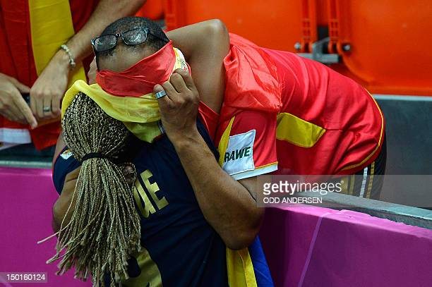 Spain's rightback Marta Mangue Gonzalez celebrates with a relative at the end of the women's bronze medal handball match South Korea vs Spain for the...