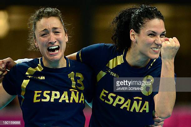 Spain's rightwing Jessica Alonso Bernardo and Spain's pivot Veronica Cuadrado Dehesa celebrate at the end of the women's bronze medal handball match...