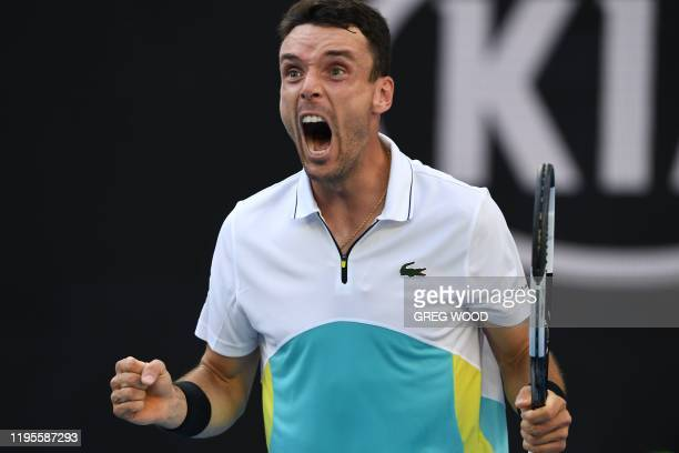 Spain's Roberto Bautista Agut celebrates a point against Croatia's Marin Cilic during their men's singles match on day five of the Australian Open...