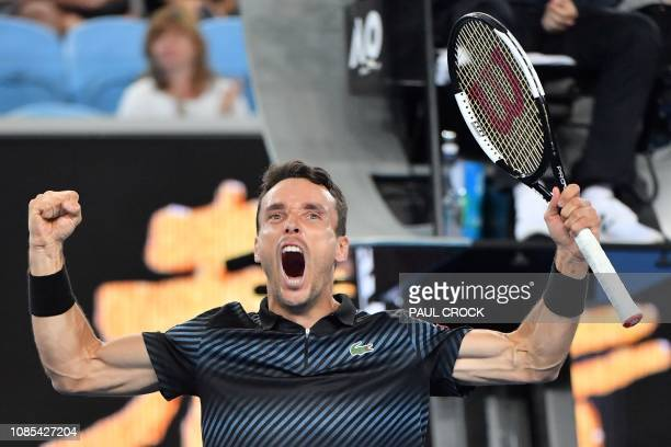 TOPSHOT Spain's Roberto Bautista Agut celebrates his victory against Croatia's Marin Cilic after their men's singles match on day seven of the...