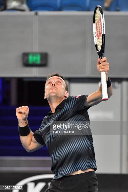 Spain's Roberto Bautista Agut celebrates his victory against Croatia's Marin Cilic after their men's singles match on day seven of the Australian...