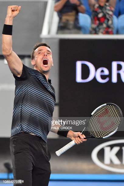 Spain's Roberto Bautista Agut celebrates his victory against Croatia's Marin Cilic during their men's singles match on day seven of the Australian...