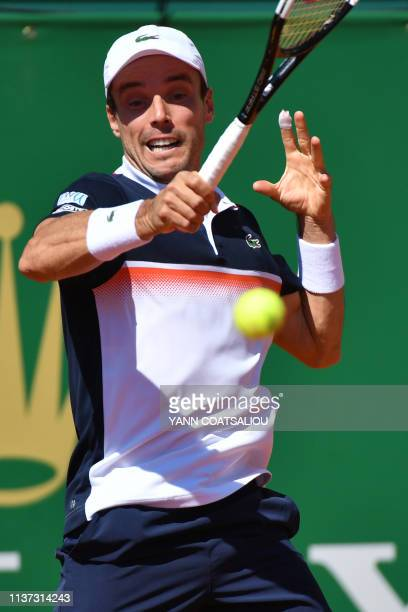 Spain's Roberto Bautista Agut plays a forehand return to Australia's John Millman during their tennis match on the day 3 of the MonteCarlo ATP...