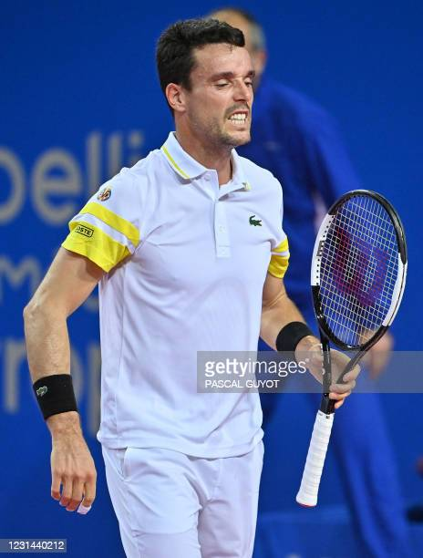 Spain's Roberto Bautista Agut reacts after a point against Belgium's David Goffin during the final match of the ATP World Tour Open Sud de France...