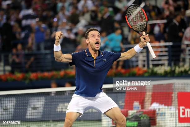 Spain's Roberto Bautista Agut reacts after defeating France's Lucas Pouille and winning the ATP Dubai Duty Free Tennis Championships on March 3 2018...