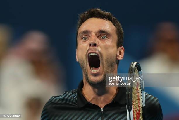 TOPSHOT Spain's Roberto Bautista Agut reacts after winning against Czech Republic's Tomas Berdych the ATP Qatar Open tennis final match in Doha on...