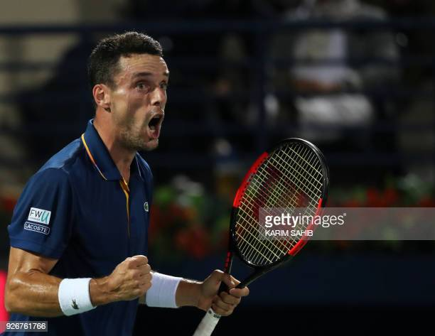 Spain's Roberto Bautista Agut reacts during his 2018 ATP Dubai Duty Free Tennis Championships final match against Lucas Pouille of France on March 3...