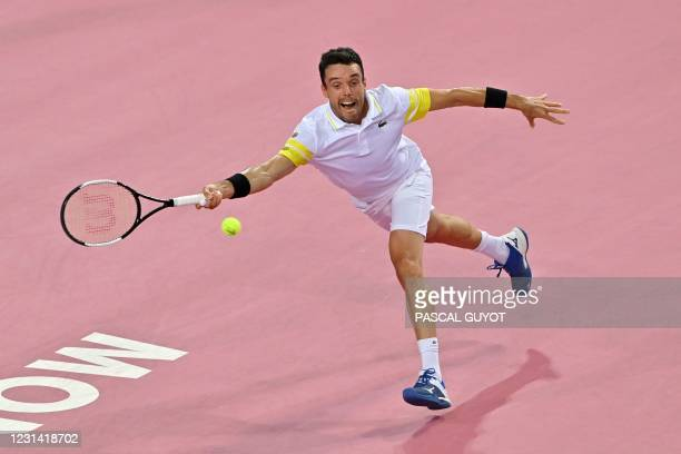 Spain's Roberto Bautista Agut returns the ball during his singles semi-final tennis match against Germany's Peter Gojowczyk during the Open Sud de...