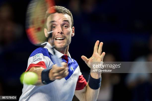 Spain's Roberto Bautista Agut returns the ball to Argentina's Juan Martin Del Potro during their quarterfinal game at the Swiss Indoors ATP 500...