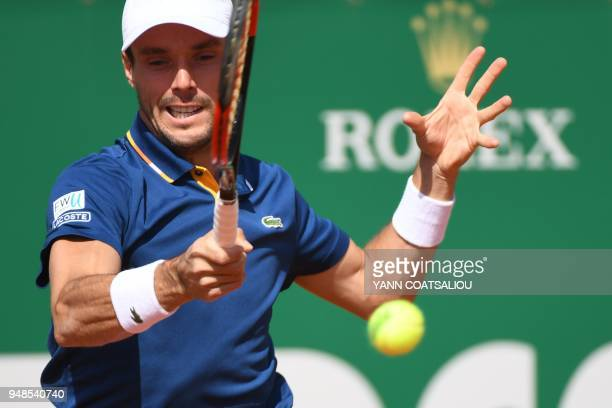 Spain's Roberto Bautista Agut returns the ball to Belgium's David Goffin during their tennis match as part of the MonteCarlo ATP Masters Series...