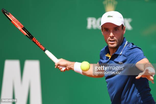 TOPSHOT Spain's Roberto Bautista Agut returns the ball to Belgium's David Goffin during their tennis match as part of the MonteCarlo ATP Masters...