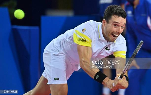 Spain's Roberto Bautista Agut returns the ball to Belgium's David Goffin during the final match of the ATP World Tour Open Sud de France tennis...
