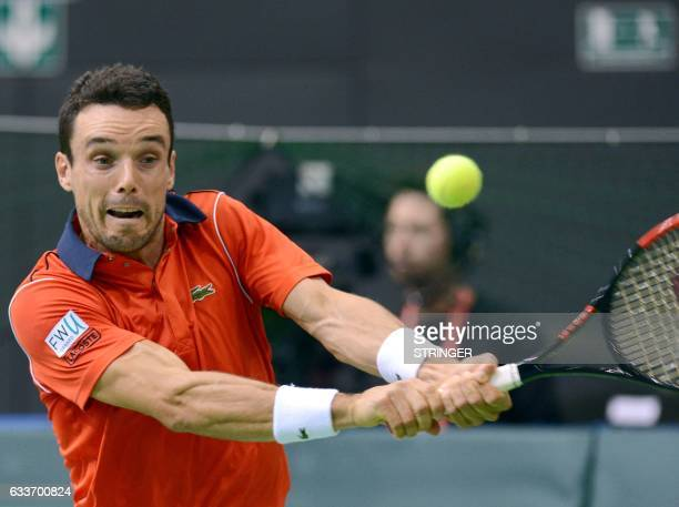 Spain's Roberto Bautista Agut returns the ball to Croatia's Ante Pavic during the first-round Davis Cup tennis match between Croatia and Spain at...