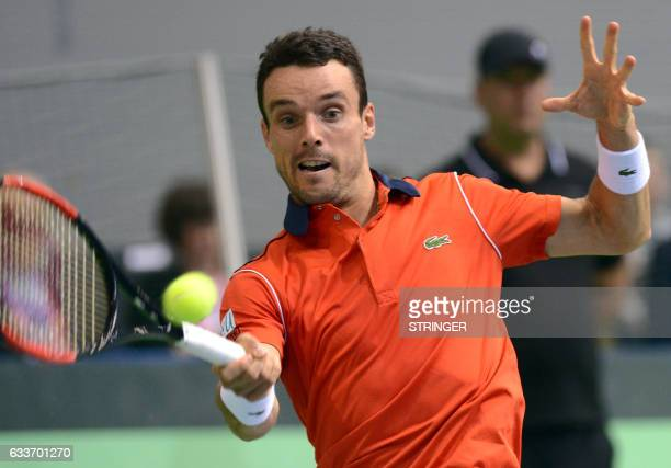 Spain's Roberto Bautista Agut returns the ball to Croatia's Ante Pavic during the first-round of the Davis Cup tennis match Croatia vs Spain at...