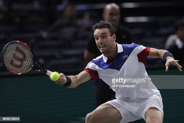 Spain's Roberto Bautista Agut returns the ball to Croatia's Marin Cilic during the 1/8 round at the ATP World Tour Masters 1000 indoor tennis...