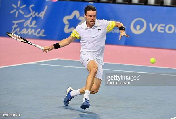Spain's Roberto Bautista Agut returns the ball to France's Ugo Humbert during their singles tennis match at the Open Sud de France ATP World Tour in...