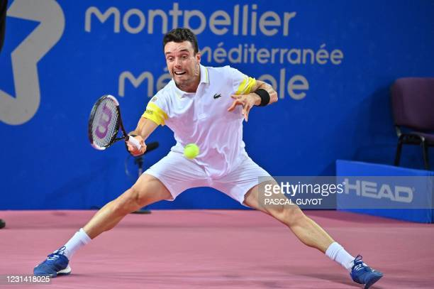 Spain's Roberto Bautista Agut returns the ball to Germany's Peter Gojowczyk during their singles semi-final tennis match against Germany's Peter...