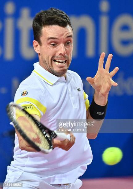 Spain's Roberto Bautista Agut returns the ball to Germany's Peter Gojowczyk during their singles semi-final tennis match at the Open Sud de France...